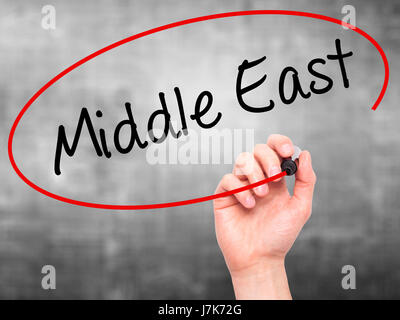 Man Hand writing Middle East with black marker on visual screen. Isolated on grey. Business, technology, internet - Stock Photo