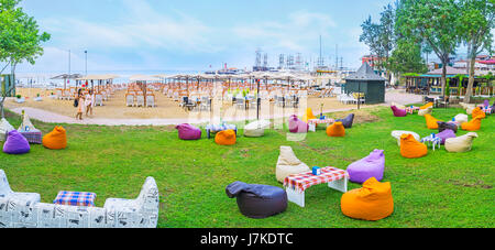 KEMER, TURKEY - MAY 5, 2017: Panorama of the lounge zone at the Moonlight beach with comfortable sun beds on the - Stock Photo
