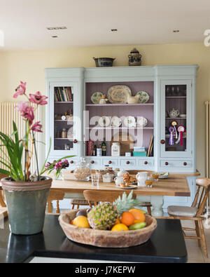Large pale blue dresser from Mark Wilkinson Furniture in large open plan kitchen. the walls are painted in Pale - Stock Photo