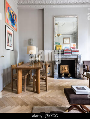 Wooden Dining Table And Chairs By Charlotte Perriand With 1940s Mirror Above French Grey Marble Fireplace
