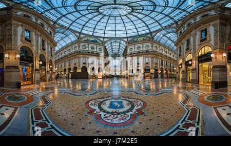 MILAN, ITALY - JANUARY 13, 2015:  Famous Bull Mosaic in Galleria Vittorio Emanuele II in Milan. It's one of the - Stock Photo