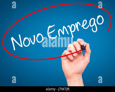 Man Hand writing  Novo Emprego (New Job in Portuguese)   with black marker on visual screen. Isolated on blue. Business, - Stock Photo