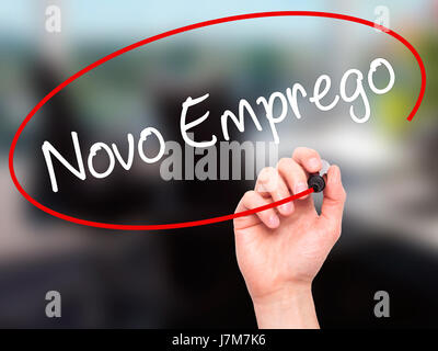Man Hand writing  Novo Emprego (New Job in Portuguese)   with black marker on visual screen. Isolated on office. - Stock Photo