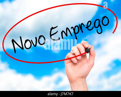 Man Hand writing  Novo Emprego (New Job in Portuguese)   with black marker on visual screen. Isolated on sky. Business, - Stock Photo
