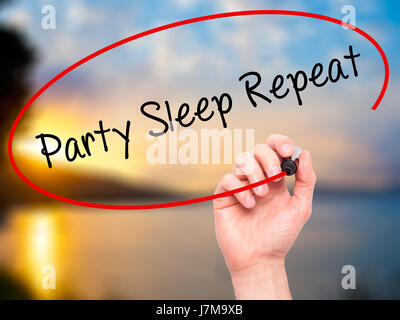 Man Hand writing Party Sleep Repeat with black marker on visual screen. Isolated on nature. Business, technology, - Stock Photo