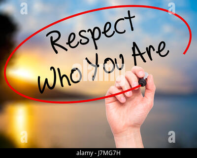 Man Hand writing Respect Who You Are with black marker on visual screen. Isolated on background. Business, technology, - Stock Photo