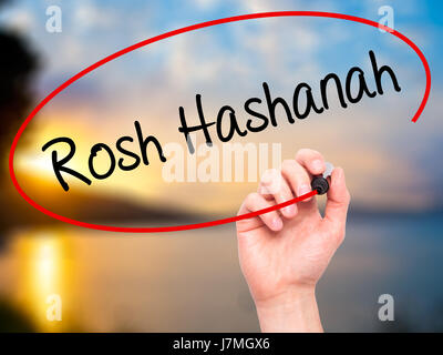Man Hand writing Rosh Hashanah with black marker on visual screen. Isolated on nature. Business, technology, internet - Stock Photo