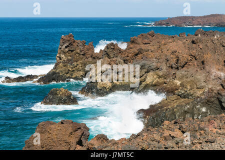 Los Hervideros rocks with splashing waves near El Golfo in Lanzarote, Spain. - Stock Photo