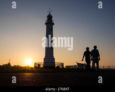 Sunderland, UK, 25th May 2017: Two men enjoy a fine evening as they pass by Cliffe Park lighthouse on a stroll along - Stock Photo