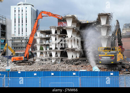 Demolition digger and buildings on construction site at Wood Street carpark near station Central Square, Cardiff - Stock Photo