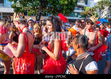 RIO DE JANEIRO - FEBRUARY 18, 2017: Young Brazilians hand out carnival promotion stickers for dating website promoting - Stock Photo