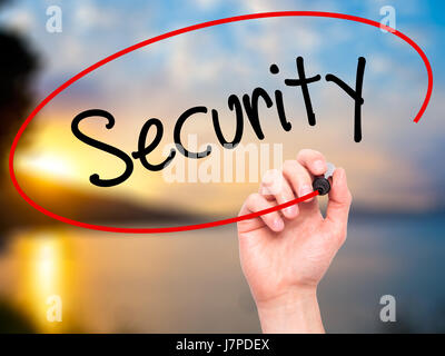 Man Hand writing Security with black marker on visual screen. Isolated on background. Business,  technology, internet - Stock Photo