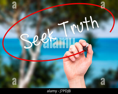 Man Hand writing Seek Truth with black marker on visual screen. Isolated on nature. Business, technology, internet - Stock Photo