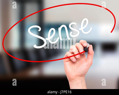 Man Hand writing  Sense with black marker on visual screen. Isolated on background. Business, technology, internet - Stock Photo