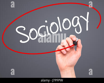 man hand writing sociology black marker on visual screen stock photo acircmiddot man hand writing sociology black marker on visual screen isolated on background business