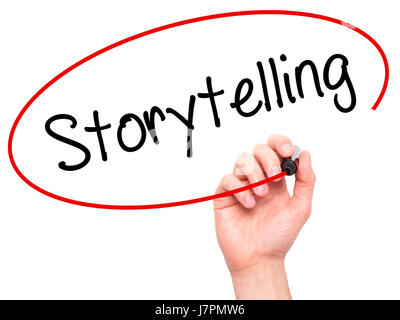 Man Hand writing Storytelling  with black marker on visual screen. Isolated on background. Business, technology, - Stock Photo