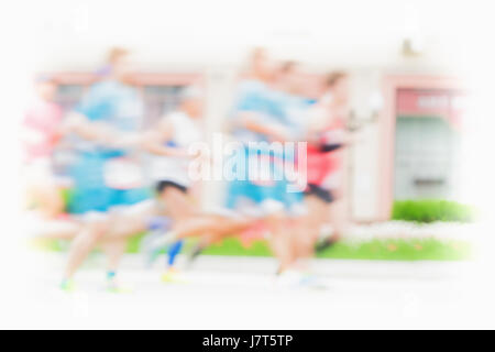 Running athletes on road, city marathon, motion blur. Group of runners. Sport, fitness, healthy lifestyle concept. - Stock Photo