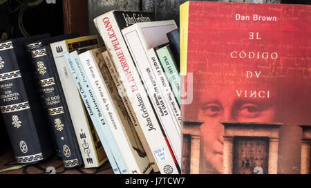 The Da Vinci Code ( Spanish version) by Dan Brown in old telephone kiosk in Spain; converted into book exchange/library - Stock Photo