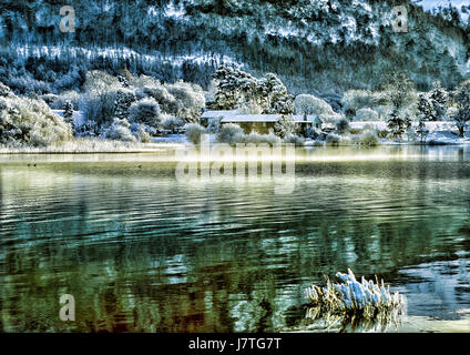 A snowy winter scene on Derwent Water - Stock Photo