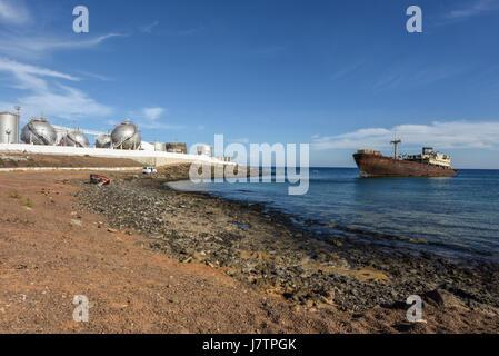 Shipwreck in industrial area. Lanzarote, Arecife, Canary Islands, Spain - Stock Photo