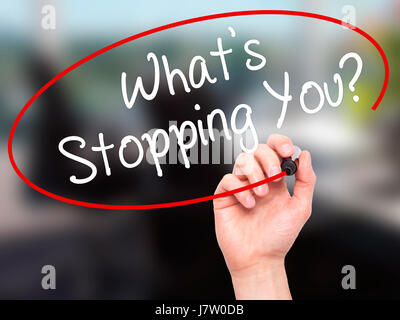 Man Hand writing What's Stopping You?  with black marker on visual screen. Isolated on office. Business, technology, - Stock Photo