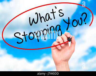 Man Hand writing What's Stopping You?  with black marker on visual screen. Isolated on sky. Business, technology, - Stock Photo
