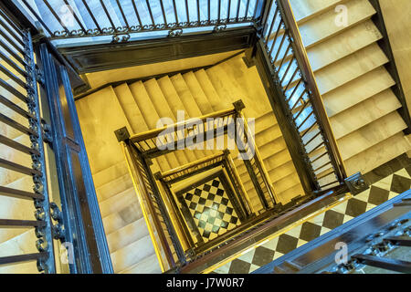 Looking down a square spiral staircase in a tall building for Square spiral staircase