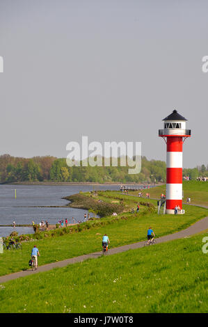 elbe dike bank lighthouse shore navigation seafaring protect protection elbe - Stock Photo