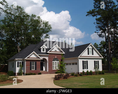 house building brick real estate gable driveway exterior home private house - Stock Photo