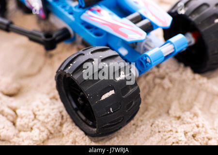 Close-up of off-road racer wheel on the sand. - Stock Photo