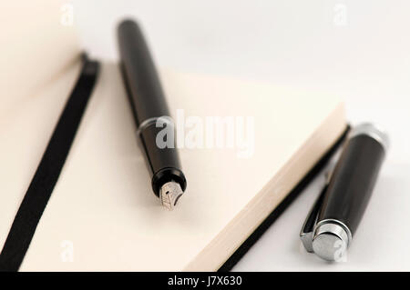 notebook and pen holder - Stock Photo