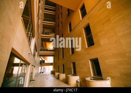 Inner courtyard of a multi-storey building. The facade of a resi - Stock Photo