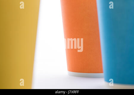 Abstract composition of yellow, blue and orange paper cups. - Stock Photo