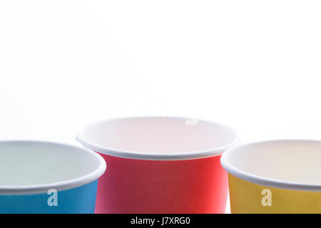 Yellow, blue and orange disposable cups isolated on white background. - Stock Photo
