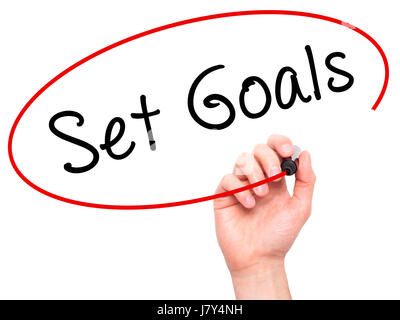 Man hand writing Set Goals on visual screen. Business,help, internet, technology concept. Isolated on white. Stock - Stock Photo