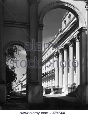 Chester Terrace, Regents Park, London, England, UK – seen through a Corinthian Arch leading to the terrace – 1960s - Stock Photo