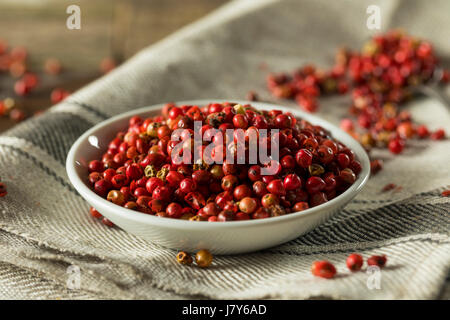 Dry Organic Red Peppercorns Ready to Grind Up - Stock Photo