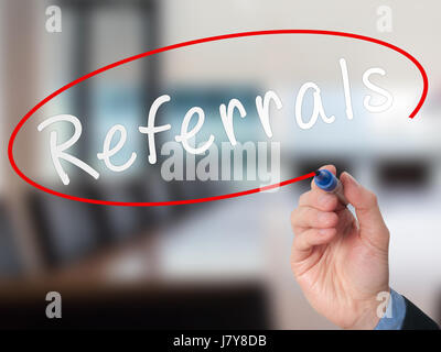 Man Hand writing Referrals with marker on virtual screen. Business, technology, internet concept. Stock Photo - Stock Photo