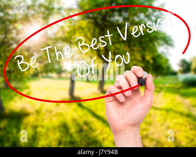 Man Hand writing Be The Best Version Of You with black marker on visual screen. Isolated on nature. Business, technology, - Stock Photo