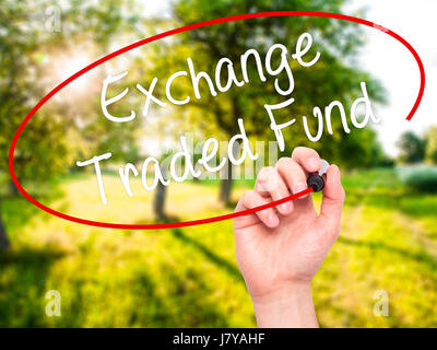 Man Hand writing Exchange Traded Fund with black marker on visual screen. Isolated on background. Business, technology, - Stock Photo