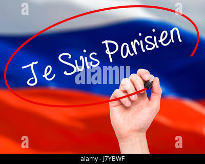 Man Hand writing Je Suis Parisien with black marker on visual screen. Isolated on flag. Stock Photo - Stock Photo