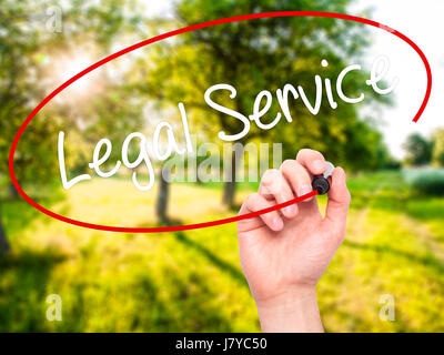 Man Hand writing Legal Service with black marker on visual screen. Isolated on background. Business, technology, - Stock Photo