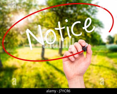 Man Hand writing Notice with black marker on visual screen. Isolated on background. Business, technology, internet - Stock Photo
