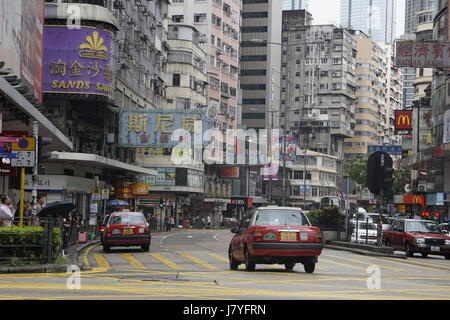 Hong Kong , Hong kong street , Taxi in Hong kong , Hong Kong Taxi , Hong Kong Building , Hong kong cab , Hong Kong - Stock Photo