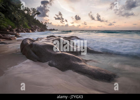 Rock formation on the beach Anse Georgette, Praslin, Indian Ocean, Seychelles - Stock Photo