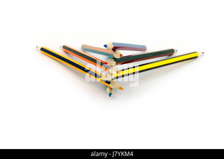 Colored pencils lie on top of each other isolated on white background - Stock Photo