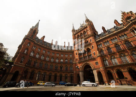 Cars park outside of the St Pancras Renaissance Hotel in London, England. The neo-Gothic building was constructed - Stock Photo