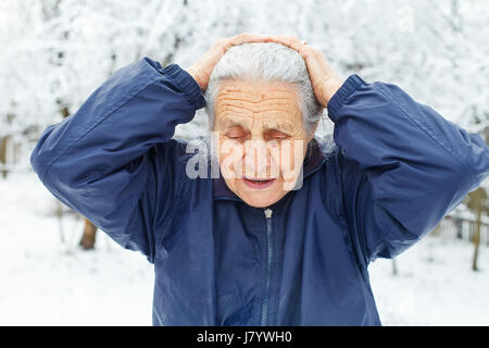 Picture of an old woman having a headache - Stock Photo