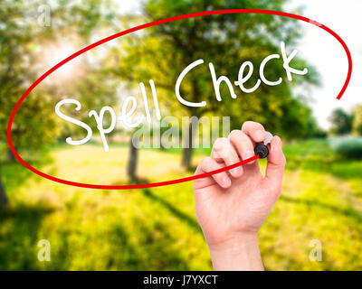 Man Hand writing Spell Check  with black marker on visual screen. Isolated on nature. Business, technology, internet - Stock Photo