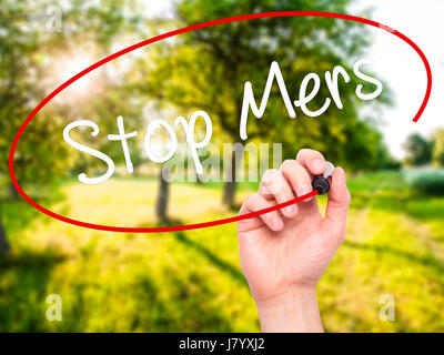 Man Hand writing Stop Mers with black marker on visual screen. Isolated on background. Business, technology, internet - Stock Photo